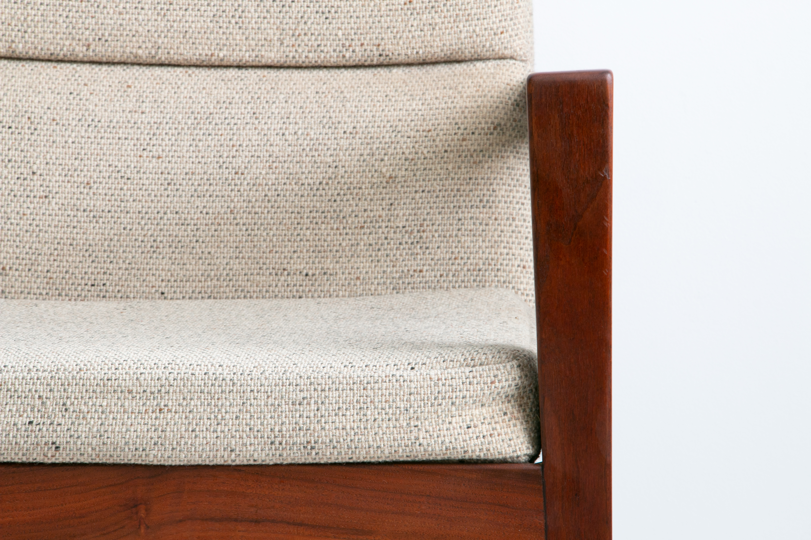 Pair of 1960's American Modern arm chairs by Jens Risom Designs in solid walnut with natural tweed upholstery.